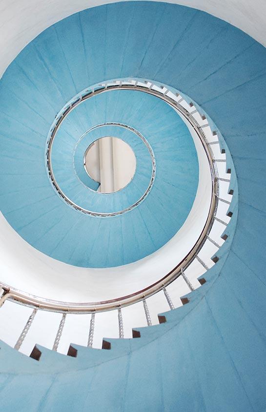 aqua spiral stair case view from below